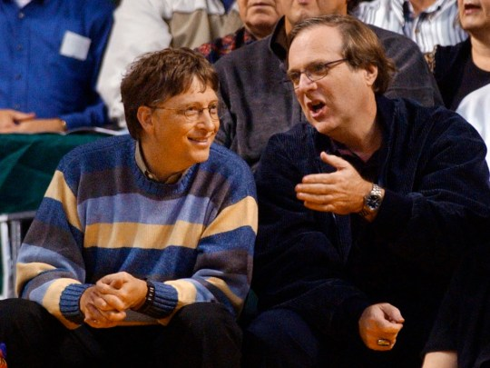 Microsoft Chairman Bill Gates, left, chats with Portland Trail Blazers owner and former business partner Paul Allen during a game between the Trail Blazers and Seattle SuperSonics in Seattle, March 11, 2003.