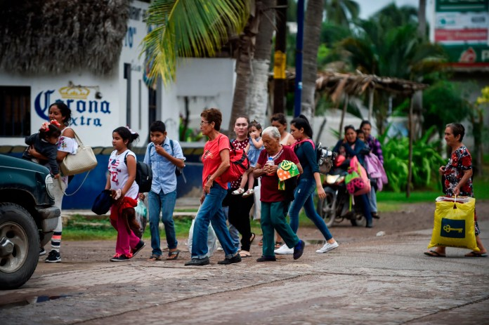 People prepare to be evacuated in Teacapan, Sinaloa state, Mexico, on Oct. 22, 2018, before the arrival of Hurricane Willa.