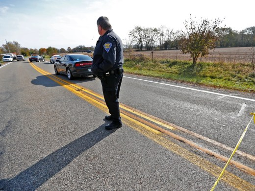 The scene is investigated near 4600 North IN State Rd. 25 north of Rochester, IN, where a pickup truck hit and killed three young children and critically injured a fourth as the children crossed the street to get on a school bus, Tuesday, Oct. 30, 2018.  The bus was stopped with lights and stop indicators in use.