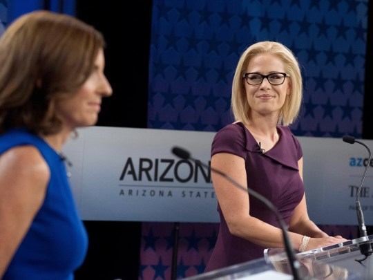 Republican Senate candidate Martha McSally, left, and Democratic Senate candidate Kyrsten Sinema, right, preparing to debate at the KAT public television station in Phoenix on Oct. 15, 2018.