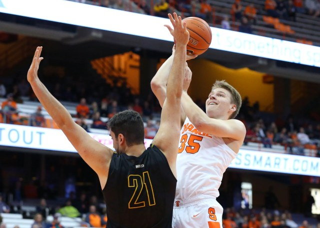 SYRACUSE, NY - OCTOBER 25:  Buddy Boeheim #35 of the Syracuse Orange shoots the ball against the defense of Jeff Allen #21 of the St. Rose Golden Knights during the second half at the Carrier Dome on October 25, 2018 in Syracuse, New York. Syracuse defeated St. Rose 80-49. (Photo by Rich Barnes/Getty Images)