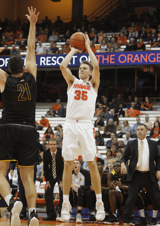 Syracuse's Buddy Boeheim (35) shoots over Saint Rose's Jeff Allen (21) during the first half of an NCAA college basketball game in Syracuse, N.Y., Thursday, Oct. 25, 2018.