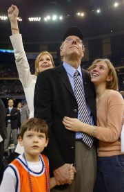 Jim Boeheim stands with his family, wife Julie, daughter Elizabeth and son James, after defeating Kansas 81-78 during the championship game of the NCAA Men's Final Four Tournament on April 7, 2003.