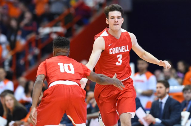 Nov 10, 2017; Syracuse, NY, USA; Cornell Big Red forward Jimmy Boeheim (3) is greeted by teammate guard Matt Morgan (10) after a made basket against the Syracuse Orange during the first half at the Carrier Dome. Mandatory Credit: Rich Barnes-USA TODAY Sports