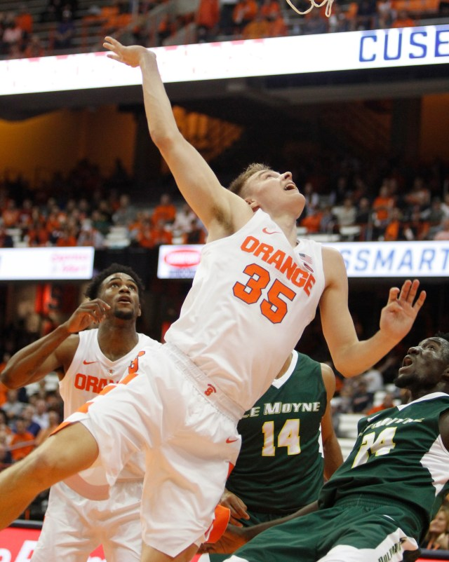 Syracuse's Buddy Boeheim falls after shooting a basket during the second half of a preseason NCAA college basketball game against Le Moyne in Syracuse, N.Y., Wednesday, Oct. 31, 2018. Syracuse won 89-52. (AP Photo/Nick Lisi)