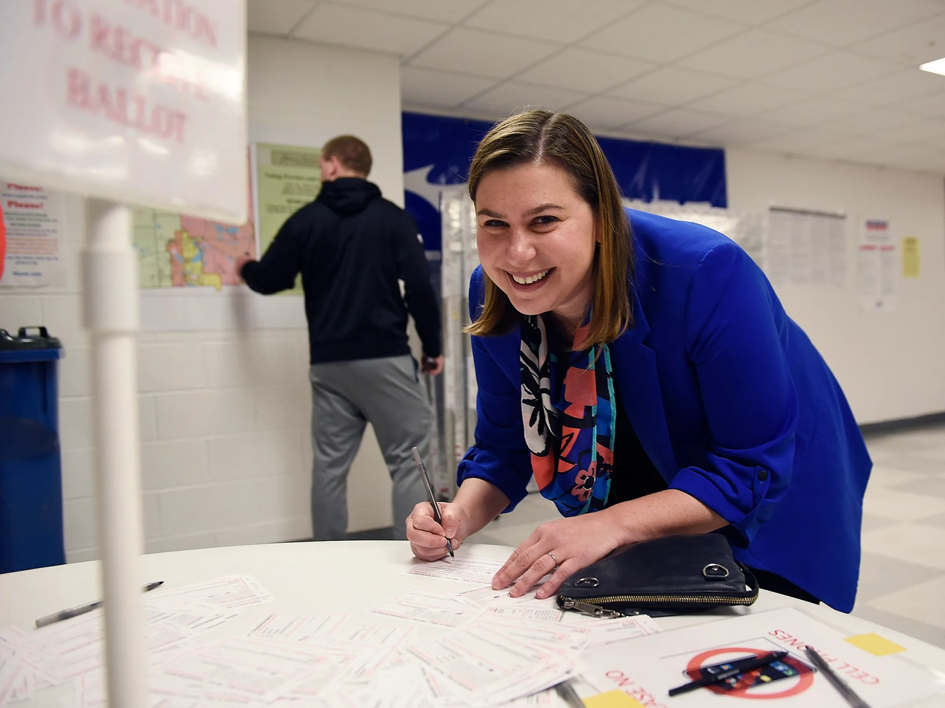 Elissa Slotkin, Democratic candidate for the U.S. House of Representatives, fills out her voting card before casting her ballot at the Karl Richter Community Center in Holly on Nov. 6, 2018.