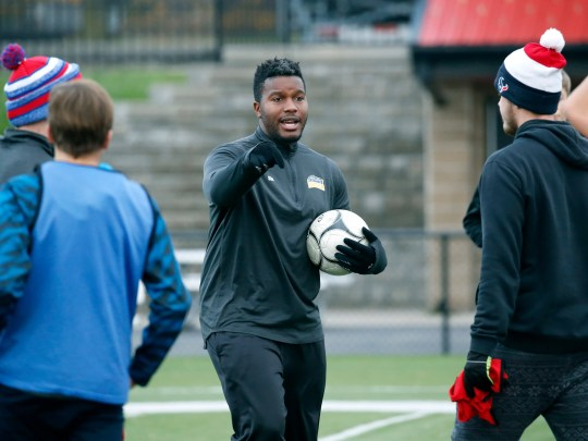 C.G. Finney boys soccer coach Steven Merritt talks to players during practice at Penfield High School this week.