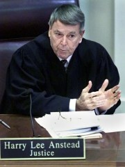 Florida Supreme Court Justice, Harry Lee Anstead, speaks during the hearing about the legality of Florida's recount.