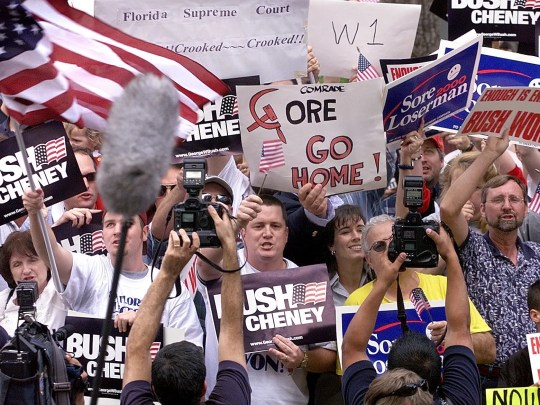 George W. Bush supporters celebrate after the Miami-Dade under vote recount stops outside the Leon County Public Library on Saturday in Tallahassee in 2001.
