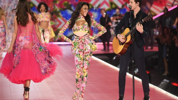 Winnie Harlow, middle, walks the runway as Shawn Mendes performs all the scheme via the 2018 Victoria's Secret Kind Stutter.