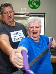 Lynda Miles, 72, completes a CrossFit Masters workout with help from her son Tim Myles, a trainer at CrossFit Batallion in Murfreesboro.