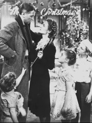 """George Bailey (Jimmy Stewart, top left) celebrates Christmas with his wife (Donna Reed) and kids (Larry Simms, Carol Coomes and Jimmy Hawkins) in """"It's a Wonderful Life."""""""
