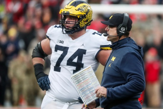Michigan head coach Jim Harbaugh talks to offensive line Ben Bredeson at a timeout during the second half against Ohio State at Ohio Stadium in Columbus, Ohio, Saturday November 24, 2018.