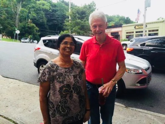 Sathi Venugopal, the mother of lohud's Swapna Venugopal Ramaswamy, with Bill Clinton in Chappaqua.