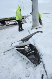 Energy Services North employees prepare to replace a fallen street light Friday, Nov. 30, 2018, in Anchorage, Alaska, one of the effects of the morning's earthquake which caused extensive damage to the local area. Scientists say the damaging Alaska earthquake and aftershocks occurred on a type of fault in which one side moves down and away from the other side.