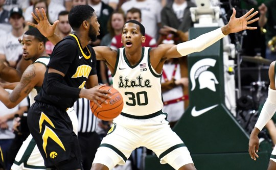 Michigan State & Marcus Bingham Jr., on the right, is guarding Iowa & Isaiah Moss during the second half on Monday, December 3, 2018, at the Breslin Center in East Lansing. Michigan State defeated Iowa 90-68.