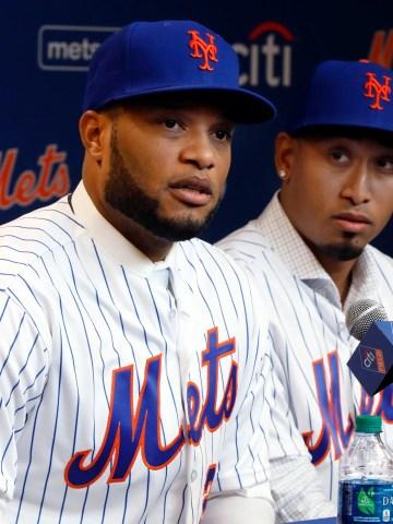 Robinson Cano, left, and Edwin Diaz are introduced at Citi Field on Tuesday.