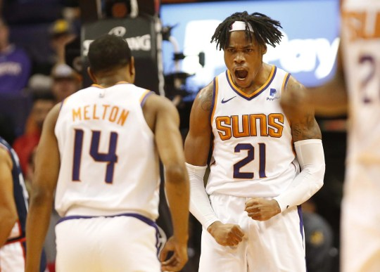 Phoenix Suns forward Richaun Holmes (21) reacts after a dunk against the LA Clippers during the second half in Phoenix, Ariz. December 10.