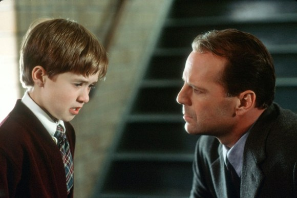 Haley Joel Osment and Bruce Willis in
