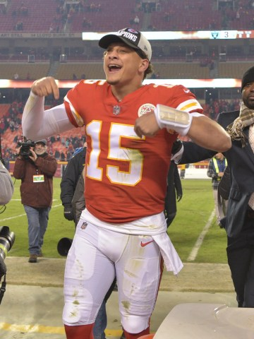 Kansas City Chiefs quarterback Patrick Mahomes (15) celebrates toward the crowd after the win over the Oakland Raiders at Arrowhead Stadium.