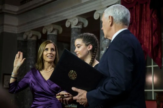 Sen. Martha McSally is sworn in by Vice President Mike Pence during the swearing-in re-enactments for recently elected senators in the Old Senate Chamber on Capitol Hill in Washington, D.C., Jan. 3, 2019.