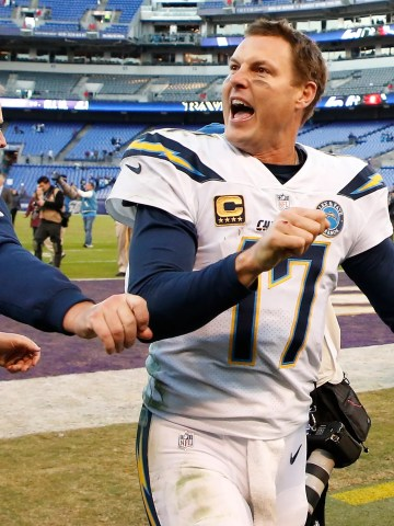 Los Angeles Chargers quarterback Philip Rivers (17) celebrates while leaving the field after the Chargers' game against the Baltimore Ravens in a AFC Wild Card playoff football game at M&T Bank Stadium.