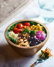 This healthy, balanced bowl at Sprout contains red onions, beans, charred corn, rice and more.