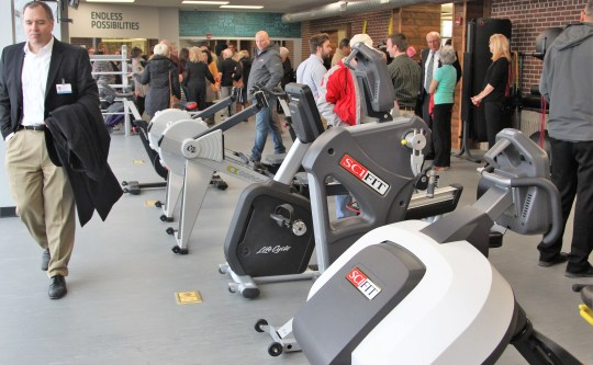 People walk around the 2,000 square foot expansion of the Marion Family YMCA's wellness center on Thursday. The approximately $500,000 project ended in January.