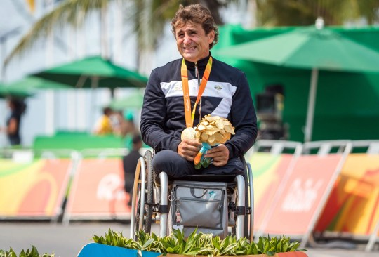 Alex Zanardi is overcome by emotion after winning gold in the Men's Time Trial H5 during the Rio 2016 Paralympic Games.