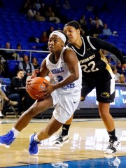 MTSU's guard Taylor Sutton (2) pushes toward the basket as Southern Miss' Megan Brown (22) covers her on Thursday Jan. 10, 2019.