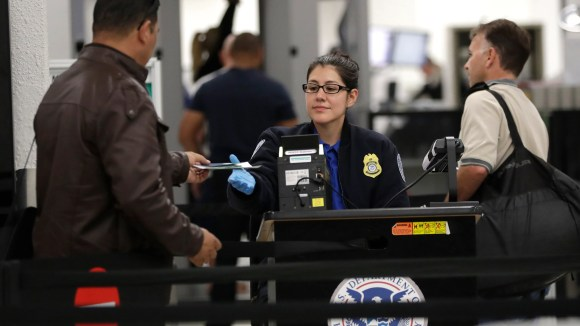 This file photo from Jan. 6, 2019, shows a Transportation Security Administration officer at a checkpoint at Miami International Airport.