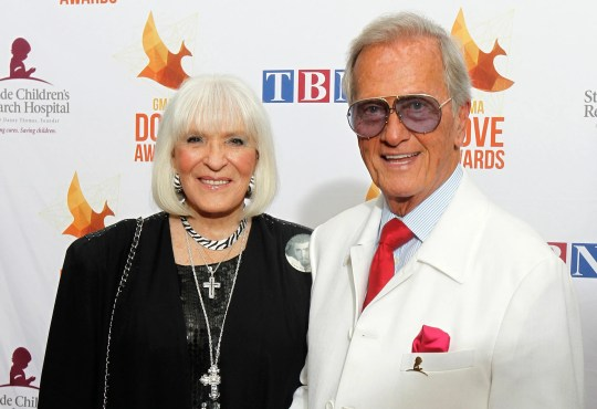 In this Oct. 7, 2014, file photo, Pat Boone, right, and wife Shirley Boone arrive at Lipscomb University for the Dove Award, in Nashville, Tenn. Shirley Boone, the longtime wife of singer Pat Boone as well as a philanthropist, has died at age 84.