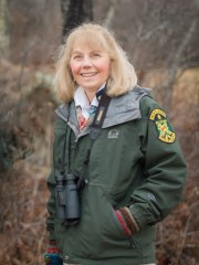 Kim Royar, a wildlife biologist at the Vermont Fish & Wildlife Department, poses in the field in this undated photo.