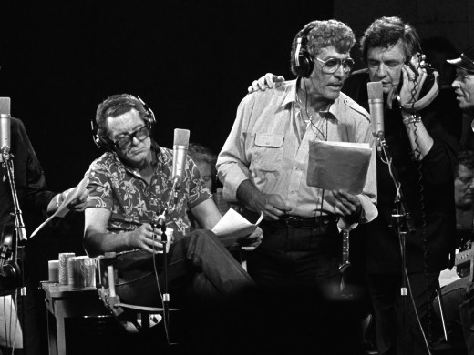 """LEFT to RIGHT:  Roy Orbison, Jerry Lee Lewis, Carl Perkins, Johnny Cash and producer Chips Moman sing during the recording of the """"Class Of 55"""" on September 20, 1985.  Moman recorded the reunion album using the four legnedary rock 'n rollers that got their starts in Memphis.  The face between Cash and Moman is lead guitar player Reggie Young.  This scene took place at Moman's old American Recording Studio on North Thomas."""