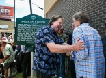 """August 13, 2014 - Songwriter Mark James, who penned Elvis Presley's hit """"Suspicious Minds"""", embraces Reggie Young, guitarist of American Sound Studios Band, during the unveiling of the American Studios historical marker at 831 Thomas Wednesday afternoon."""