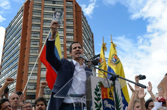 """Venezuela's National Assembly head Juan Guaido speaks to the crowd during a mass opposition rally against leader Nicolas Maduro in which he declared himself the country's """"acting president"""", on the anniversary of a 1958 uprising that overthrew military dictatorship, in Caracas on January 23, 2019."""