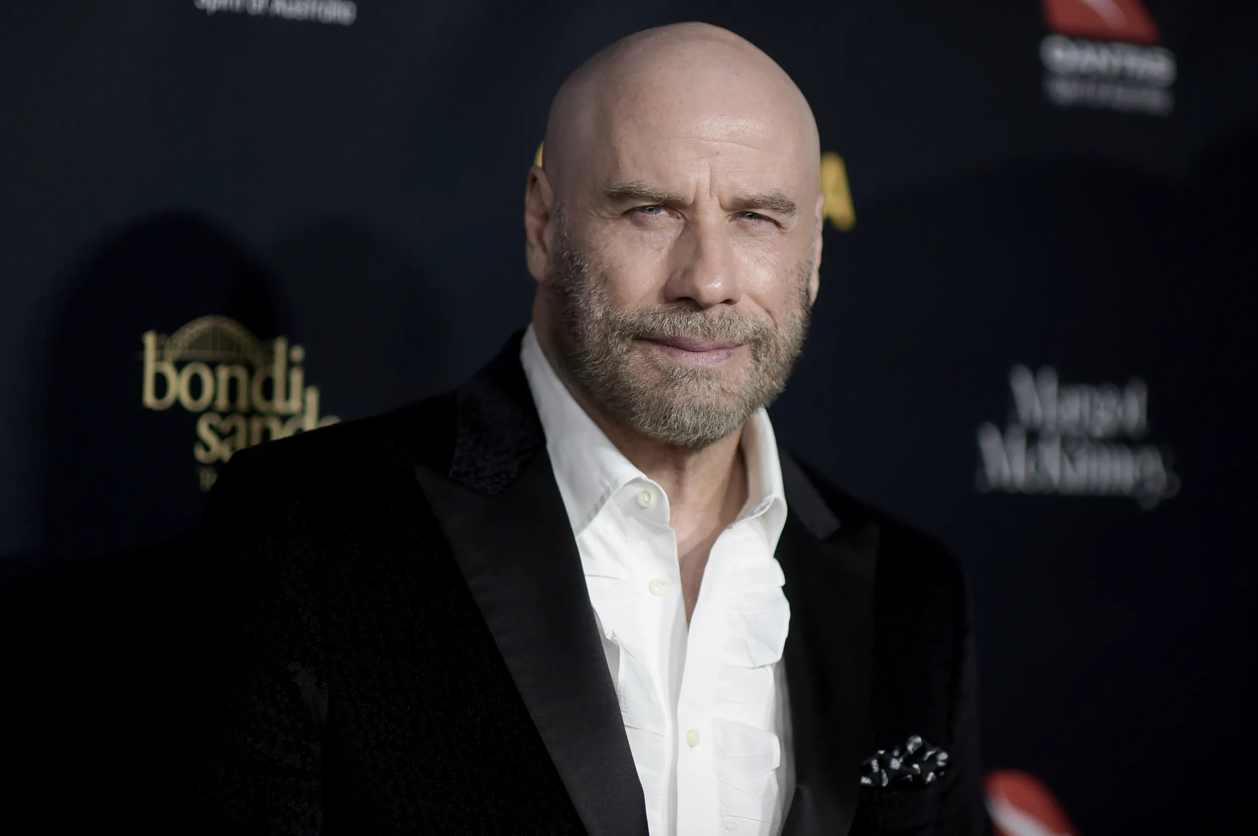 John Travolta Is Keeping The Cool Bald Look And It Feels