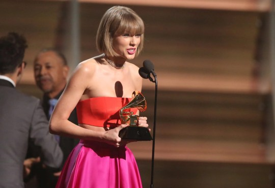 "Taylor Swift accepts the album of the trophy of the year for ""1989"" in 2016."
