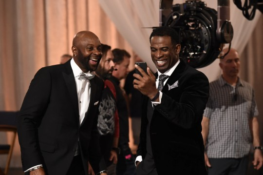 Former NFL greats Jerry Rice (left) and Deion Sanders share a laugh during filming of the NFL's Super Bowl ad.