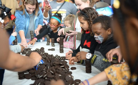 Jeugddorpen Soepzondag is a family event, with activities such as Oreo stacking competitions for children.