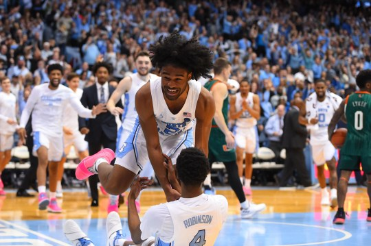 North Carolina Tar Heels guard Coby White (2) and guard Brandon Robinson (4) react at the end of the game. The Tar Heels defeated the Miami (Fl) Hurricanes in overtime at Dean E. Smith Center.