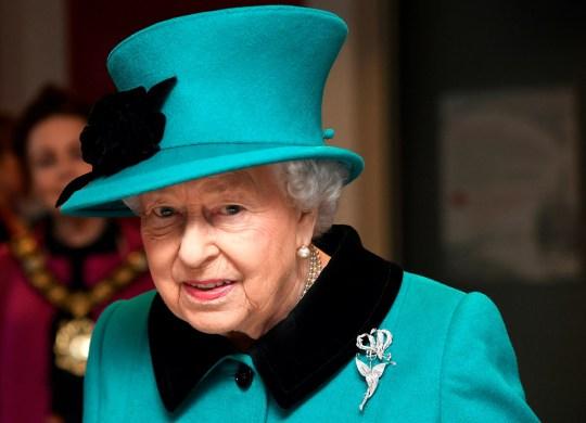 Britain's Queen Elizabeth II visits the children's charity, Coram, in London, on Dec. 5, 2018.