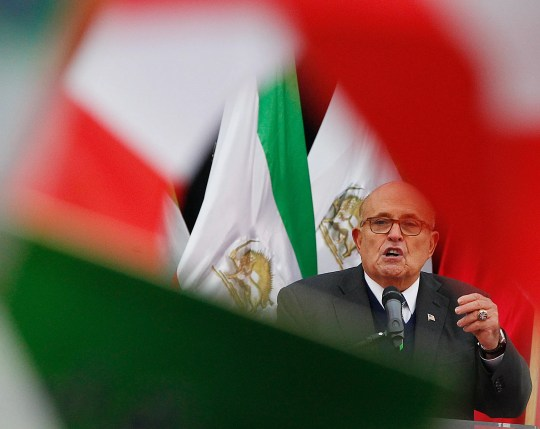 President Donald Trump's attorney Rudy Giuliani addresses a rally of a few hundred members of an Iranian opposition group ahead of a conference on the Middle East, in Warsaw, Poland, on Feb. 13, 2019.