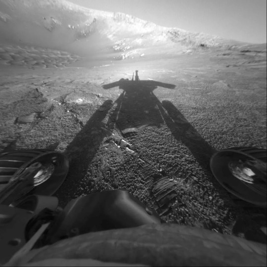 This July 26, 2004, photo made available by NASA shows the shadow of the Mars Exploration Rover Opportunity as it traveled farther into Endurance Crater in the Meridiani Planum region of Mars.