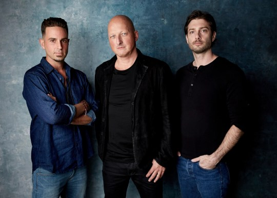 """Wade Robson, left, """"Leaving Neverland"""" director Dan Reed and James Safechuck pose for a portrait in Park City, Utah, last month."""