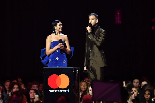 Dua Lipa, left, and Calvin Harris accept the British Single award at the Brit Awards Wednesday in London.