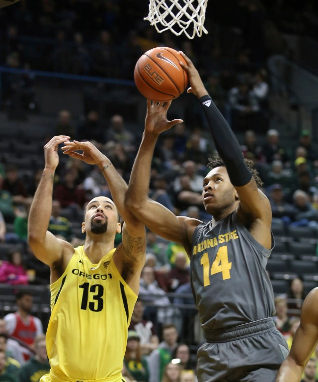 Arizona State's Kimani Lawrence, right, pulls down a rebound next to Oregon's Paul White during the first half of an NCAA college basketball game Thursday, Feb. 28, 2019, in Eugene, Ore.