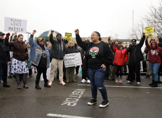 Tanya Faison, of Black Lives Matter, addresses a demonstration outside the Sacramento Police Department to protest the decision to not prosecute the two officers involved in the 2018 fatal shooting of Stephon Clark, in Sacramento, Calif., Saturday, March 2, 2019.