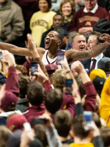 March 5: Minnesota Golden Gophers guard Dupree McBrayer (top) acknowledges the crowd following a game against the Purdue Boilermakers at Williams Arena.