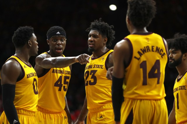 ASU's Zylan Cheatham (45) talks with teammates Luguentz Dort (0) and Romello White (23) during the second half at the McKale Memorial Center in Tucson, Ariz. on March 9, 2019.